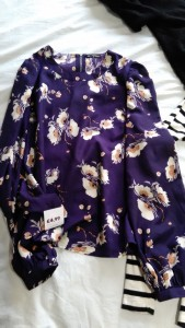 Purple satin long sleeved top with floral design
